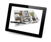 Designing a house on a tablet pc — Foto Stock