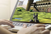 Gaming on a laptop — Stock Photo