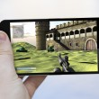 Smartphone with videogame on the screen — Stock Photo #71164295