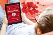 Man online dating on a tablet — Stock Photo