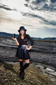 Sexy photographer on mud volcanoes landscape — Stock Photo