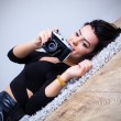Sexy young woman taking pictures — Stock Photo #64091861