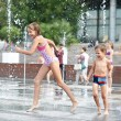 Happy children playing in a fountain — Stock Photo #53036237
