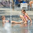 Children playing in puddle on hot weather — Stock Photo #53036409