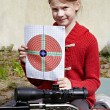 Girl with a target and a pneumatic gun — Stock Photo #55044927