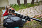 Girl aiming a airguns — Stok fotoğraf
