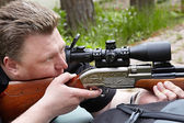 Rifle shooting with optical sight — Stok fotoğraf