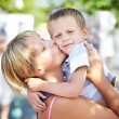 Happy mother kisses her son — Stock Photo #56516527