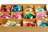 Christmas balls in a carboard box — Stock Photo