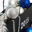 Christmas balls and tinsel in gift bag symbol of New Year isolat — Stock Photo #58267303