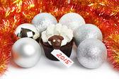 Cake lamb with silver Christmas balls and tinsel as simbol 2015 — Stock Photo