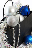 Christmas balls and tinsel in gift bag symbol of New Year isolat — Стоковое фото
