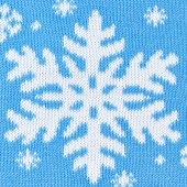 Knitted blue background with snowflakes — Stock Photo