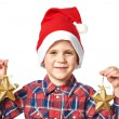 Little boy in red Santa hat with golden stars — Stock Photo #58994295