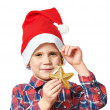 Little boy in red Santa hat with golden star — Stock Photo #58994315
