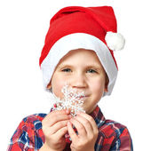 Little boy in red Santa hat with snowflake — Stock Photo