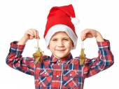 Little boy in red Santa hat with golden stars — Stock Photo