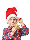 Little boy in red Santa hat with golden star — Stock Photo