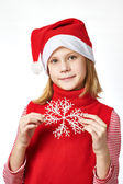 Beautyful girl in red Santa hat with snowflake — Стоковое фото