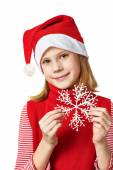 Beautyful girl in red Santa hat with snowflake — Fotografia Stock