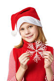 Beautyful girl in red Santa hat with snowflake — Foto Stock