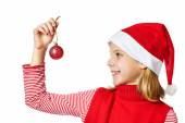 Beautyful girl in red Santa hat with christmas ball — Stock Photo