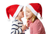 Girl and little boy in Santa Claus hat — Stock Photo