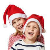 Girl and little boy in Santa Claus hat — Foto Stock
