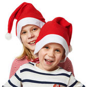 Girl and little boy in Santa Claus hat — 图库照片