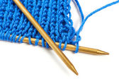 Two spokes with knit blue woolen cloth isolated macro — Stock Photo
