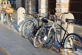 Bikes parked on streets of European city — Stock Photo