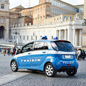 Police car on area of big city — Stock Photo