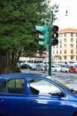 Yellow traffic lights for pedestrians on crossroads — Stock Photo