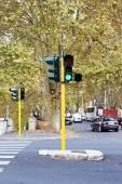 Green traffic lights on street of city — Stock Photo