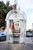 Modern public telephone on city street — Stock Photo