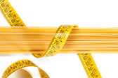 Spaghetti and measuring tape — Stock Photo