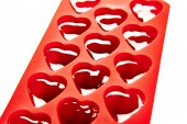 Red container for ice form of hearts — Stock Photo