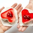 Jelly heart-shaped cakes in hands of lovers — Stok fotoğraf #62284261