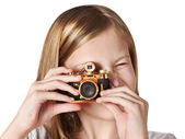 Girl photographer takes picture retro camera isolated — Stock Photo