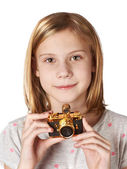 Girl photographer with retro golden camera — Stock Photo