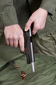 Soldier shutter cocking pistol gun Colt — Stock Photo