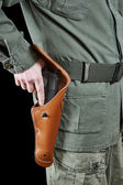 Soldier takes out gun from holster — Stock Photo