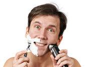 Man shaving with razors — Zdjęcie stockowe