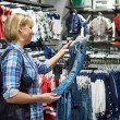 Woman shopping clothes for childrens — Stock Photo #65578277