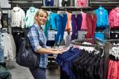 Beautiful woman shopping in clothing store — Stock Photo