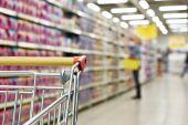 Cart buyer in supermarket — Stock Photo
