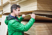 Man shopping for plywood in shop — Stock Photo