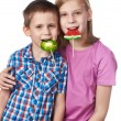 Girl and boy eating a lollipops — Stock Photo #66259091