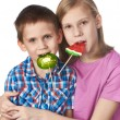 Girl and boy eating a lollipops — Stock Photo #66259137