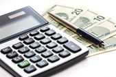 Calculator, pen and money isolated — Stock Photo